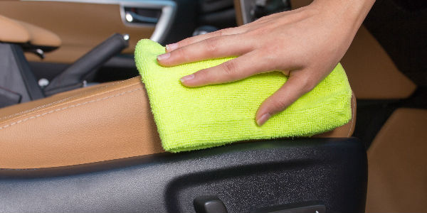 Hand Cleaning Tan Leather Interior with Yellow Cloth