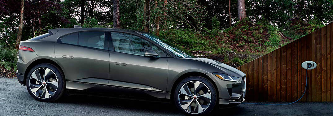 Gray 2019 Jaguar I-PACE EV Being Charged in a Driveway