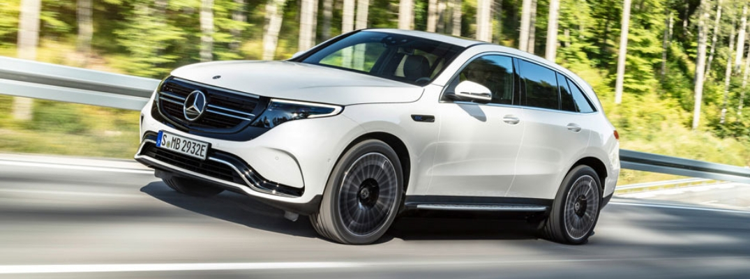 Photo of White Mercedes-Benz EQC Driving Down Road