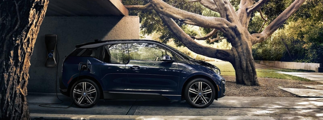 Black 2019 BMW i3 Being Charged at Home in a Driveway