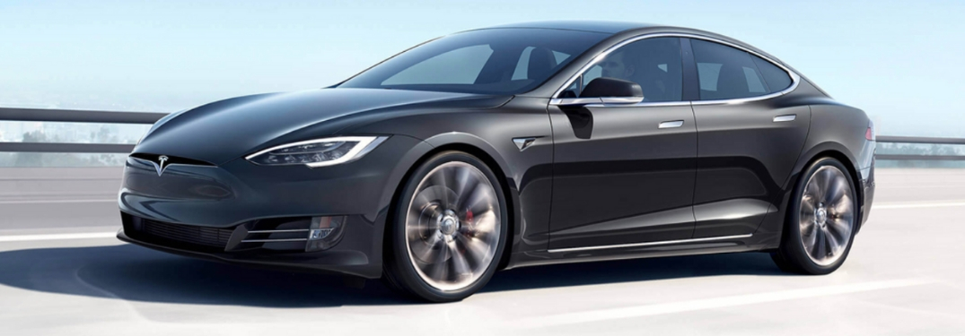 Gray Tesla Model S Side Exterior on a Freeway