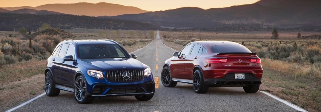 Blue 2018 Mercedes-Benz GLC and Red 2018 Mercedes-Benz GLC Coupe on a Desert Highway