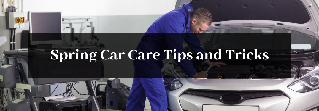 Male Mechanic on Blue Under the Hood of a Car with a Black Rectangle and White Spring Car Care Tips and Tricks Text
