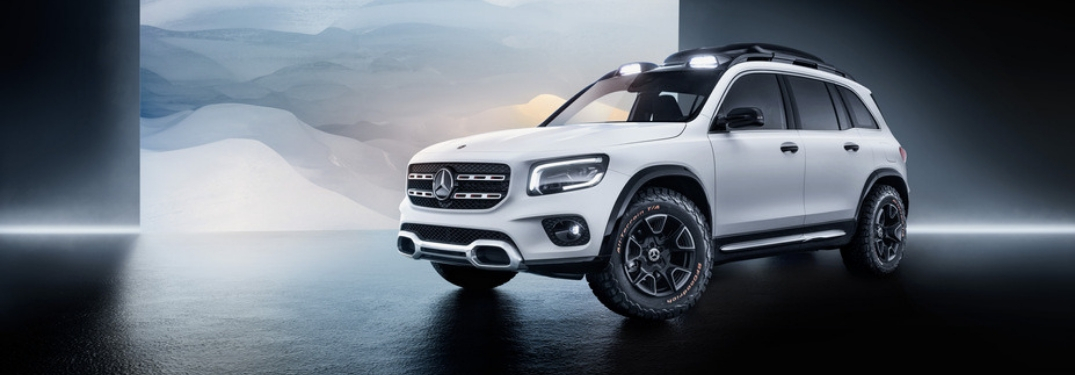 White Mercedes-Benz GLB Concept Front and Side Exterior in Front of Snowy Background Image