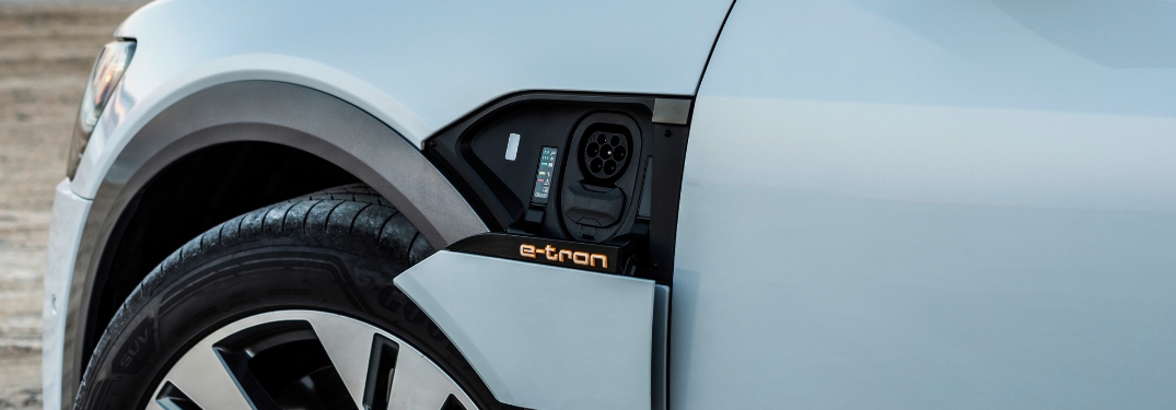 Close Up of Audi e-tron Charging Port with Illuminated e-tron Badge
