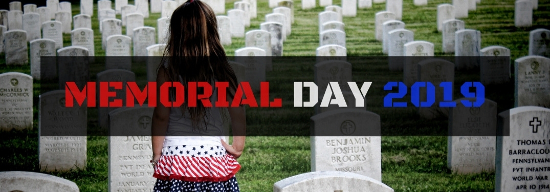 Young Girl Standing in Cemetery with Black Rectangle with Red, White and Blue Memorial Day 2019 Text