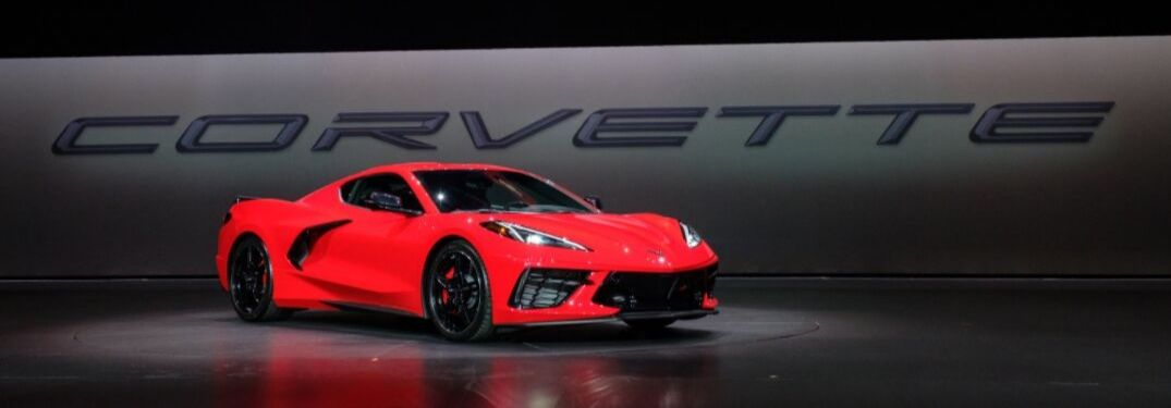 Red 2020 Chevy Corvette on Stage at Debut with Black Corvette Banner in Background
