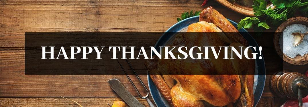 Table with Turkey on a Plate and Black Text Box with White Happy Thanksgiving! Text
