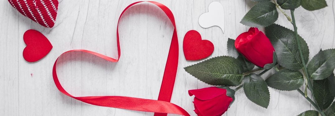 Ribbon Heart and Red Roses on White Background with Red and White Hearts
