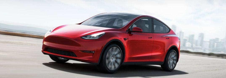 Red Tesla Model Y on a Freeway
