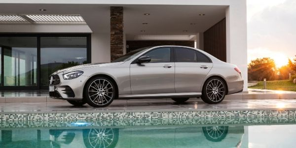 Bronze 2021 Mercedes-Benz E-Class Sedan Side Exterior Next to House