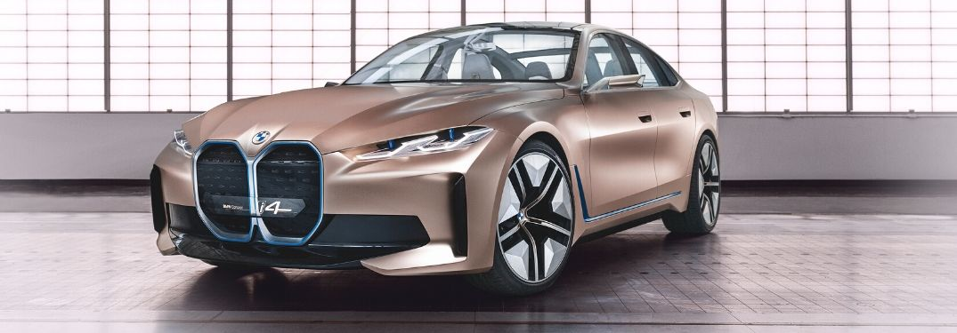Gold BMW Concept i4 Front and Side Exterior in Warehouse