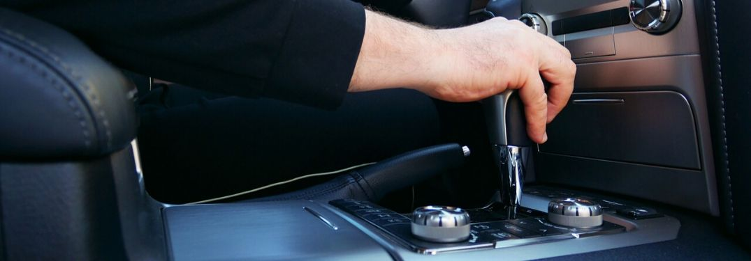 Hand Using Automatic Transmission in a Car