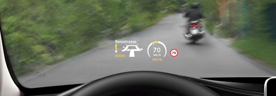 Mercedes-Benz C-Class Head-Up Display on the Road with Motorcycle in Front of the Car