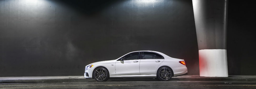 2019 MB E-Class exterior drivers side profile in tunnel parked by wall with dramatic lighting