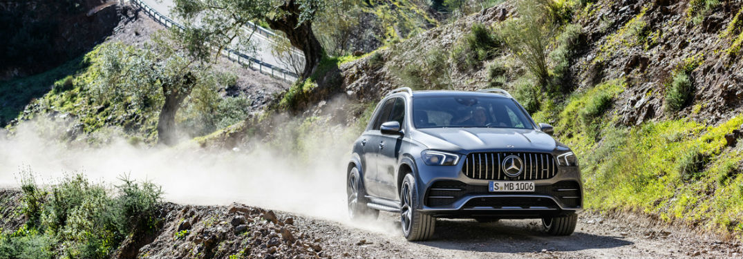 2021 MB AMG GLE 53 exterior front fascia and passenger side kicking up dust on dirt road