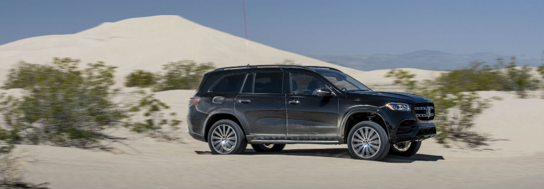 2020 MB GLS SUV exterior front fascia passenger side in desert with foliage