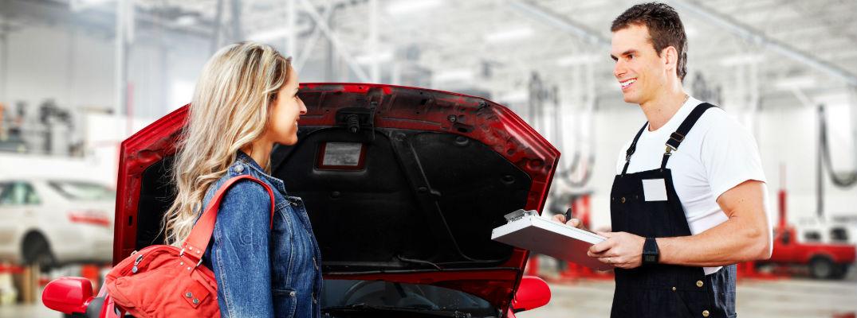 A mechanic talking to a woman