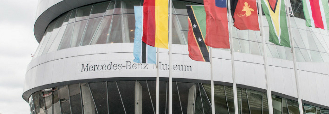 mercedes-benz museum closeup with flying flags