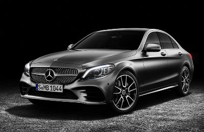 2019 MB C-Class Sedan exterior front fascia and drivers side with dramatic lighting