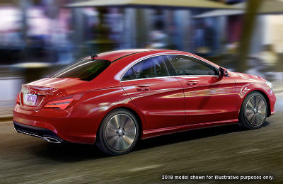 2019-MB CLA exterior back fascia and passenger side with blurred surroundings in city