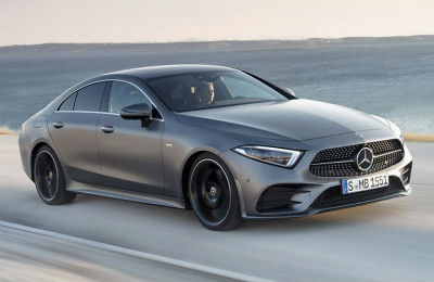 2019 MB CLS exterior front fascia and passenger side on beach road