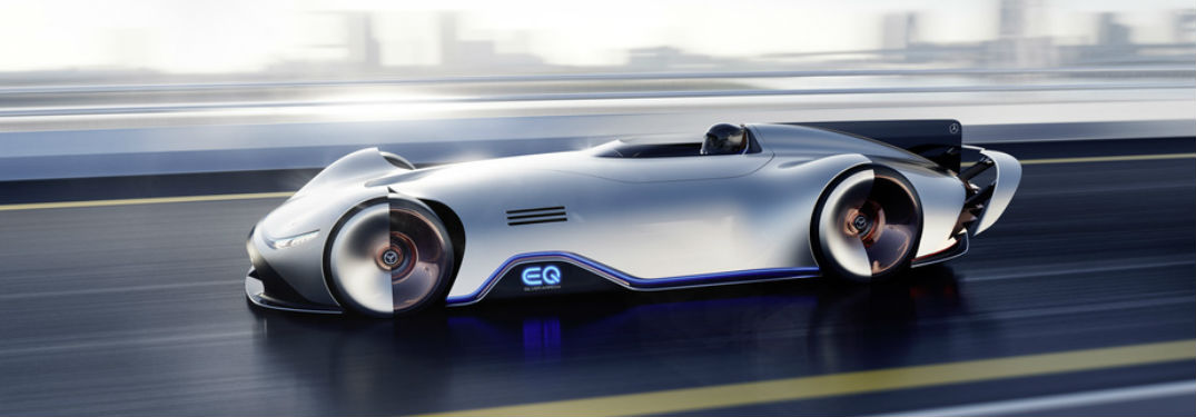 Mercedes-Benz EQ Silver Arrow exterior driver side profile going fast on blurred highway