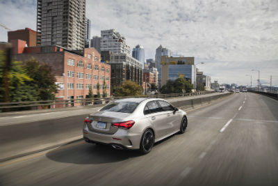 2019 MB A-Class exterior back fascia and passenger side on city highway