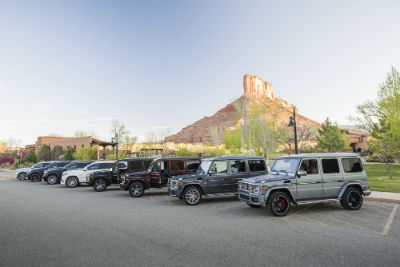 2017 GLS and 2016 G-Class vehicles lined up in parking lot