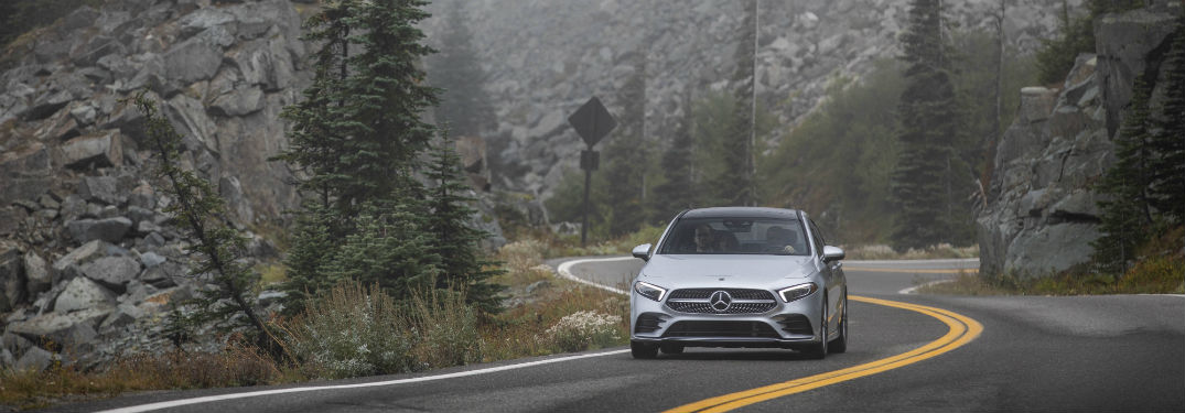 2019 MB A-Class exterior front fascia driving on winding road