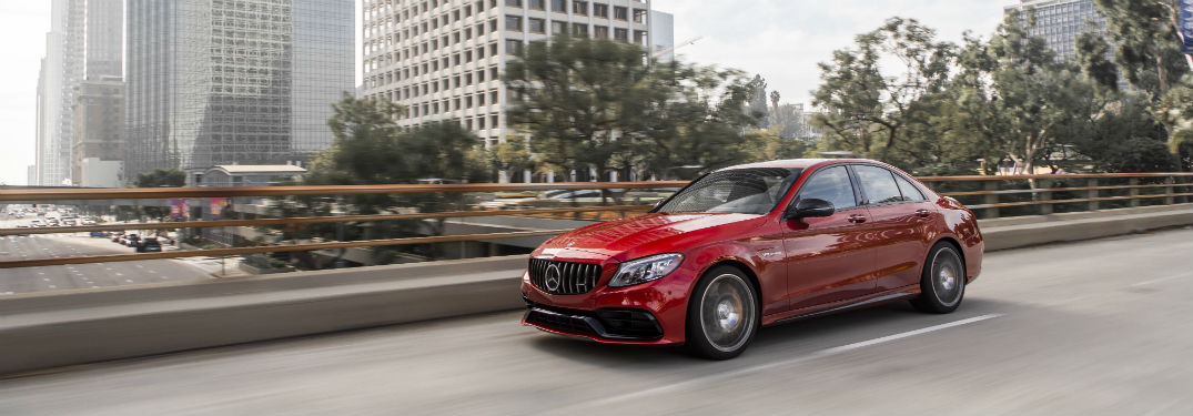2019 MB C-Class exterior front fasica and drivers side going fast on city highway