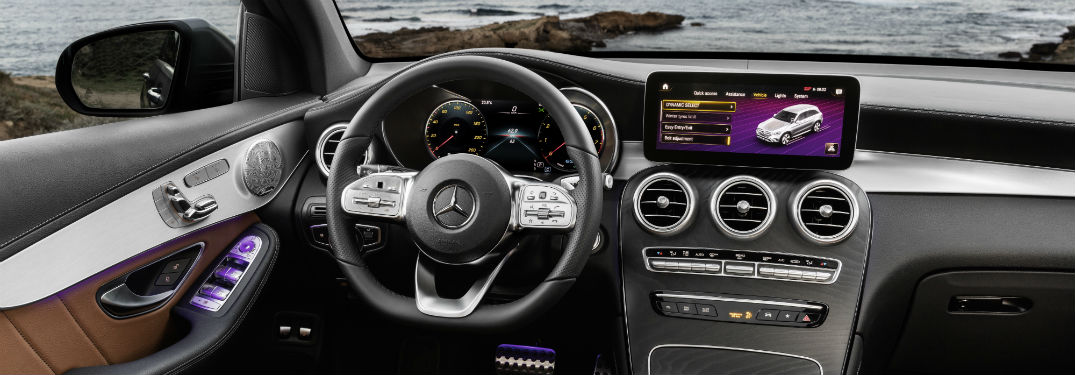 2020 MB GLC SUV interior close up of steering wheel touchscreen and partial dashboard