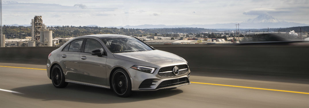 2019 MB A-Class sedan exterior front fascia and passenger side on road overlooking distant city