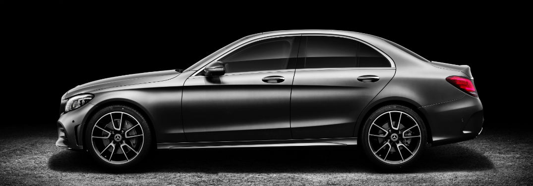 2019 MB C-Class exterior drivers side profile in dark room with dramatic lighting
