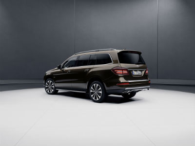 2019 MB GLS SUV exterior back fascia and drivers side in gray room with white floor