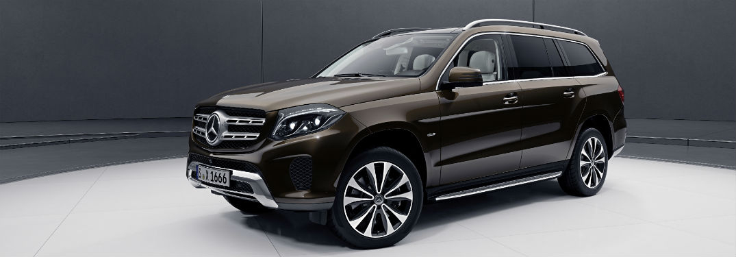 2019 MB GLS SUV exterior front fascia and drivers side in blank gray room with white floor