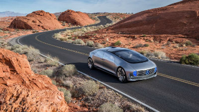 2020 F 015 exterior front fascia and passenger side on winding desert road