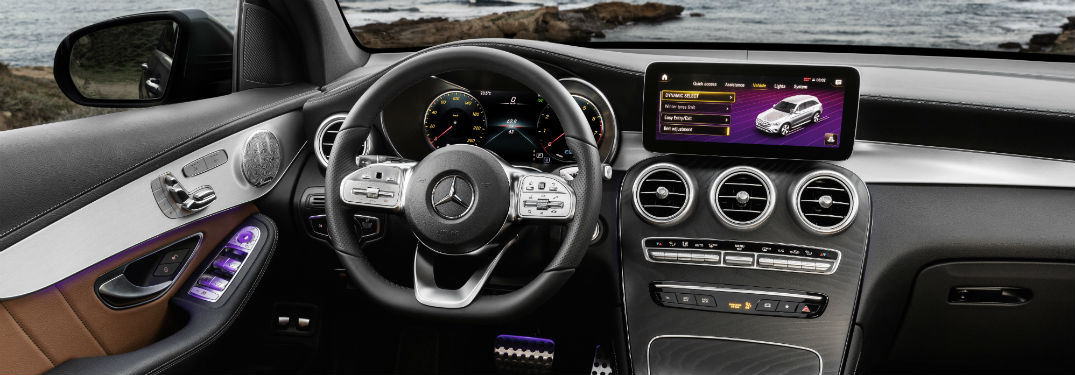 2020 MB GLC Coupe interior close up of steering wheel touchscreen and partial dashboard