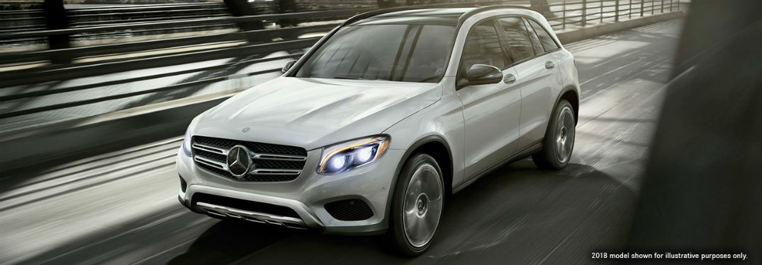 2019 MB GLC exterior front fascia and driver side going fast on blurred sunny highway