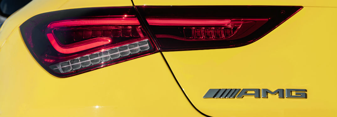 2020 MB CLA exterior back fascia close up of driver side taillight and AMG badge
