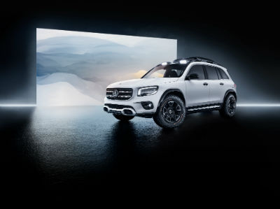MB GLB Concept exterior front fascia and passenger side in front of modern painting in dark room