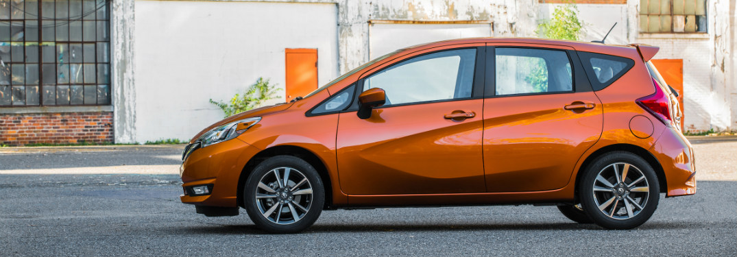orange 2018 nissan versa note exterior side view parked in front of historic building