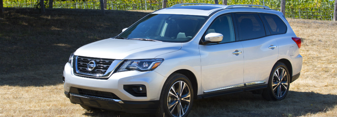 silver 2018 nissan pathfinder parked in field