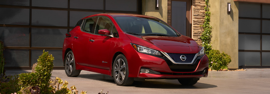 red 2018 nissan leaf in house driveway