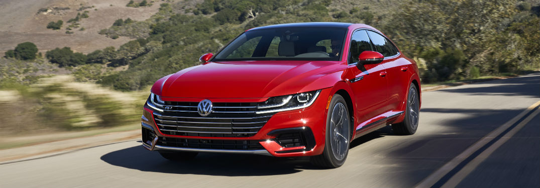 Front driver side exterior view of a red 2019 VW Arteon