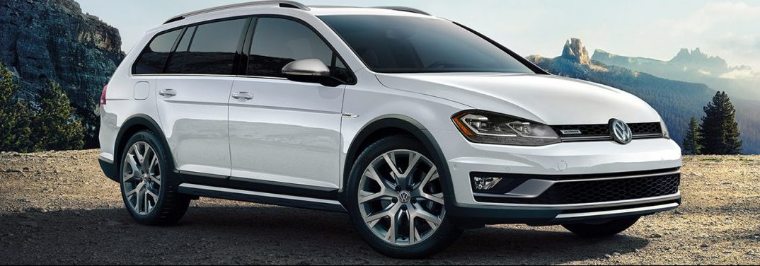 White 2019 Volkswagen Golf Alltrack parked in the middle of an off-road landscape.