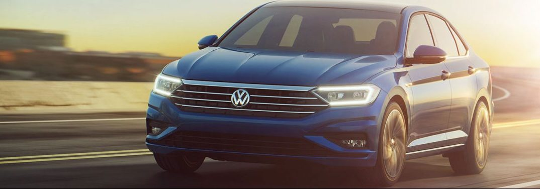 Blue 2019 Volkswagen Jetta cruises down a track with the help of its turbocharged engine.