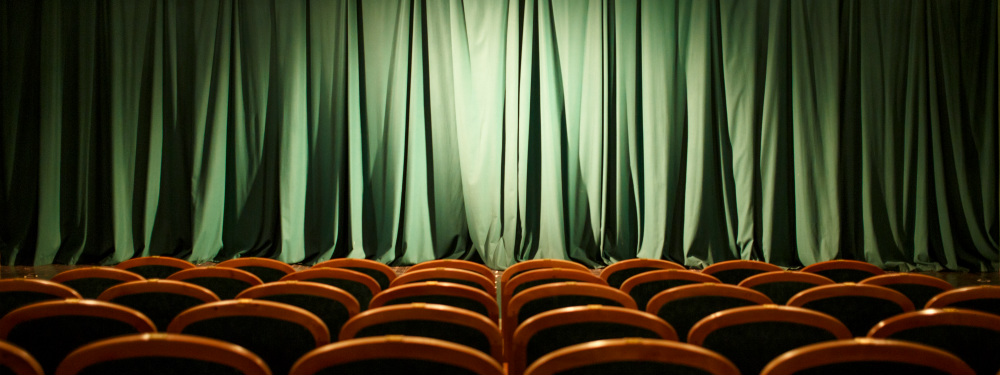 Empty theatre seats with curtains drawn