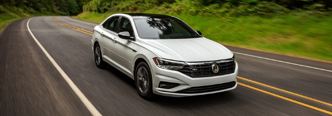 2020 Jetta driving down verdant road