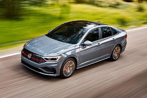 2020 Jetta GLI driving on wooded road